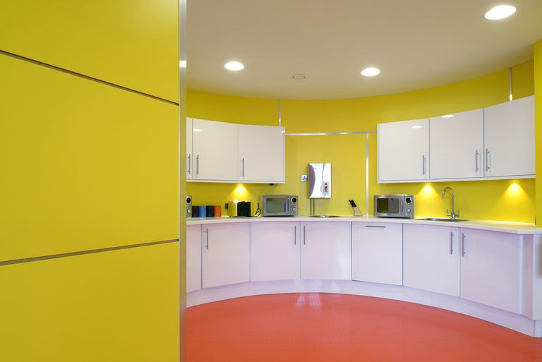Yellow and orange kitchen facilities in Fabrick Offices, Hudson Quay, Middlesbrough, UK