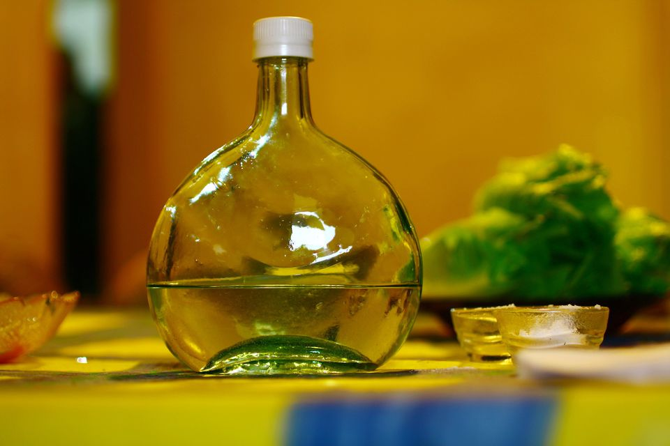 Close-Up Of Arak Bottle On Table