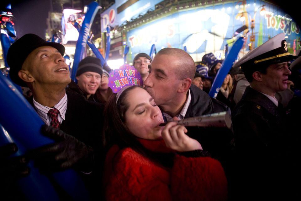 Revelers celebrate the ball drop in Times Square on January 1, 2010 in New York City. Security was tight amid preparations for the annual New Years Eve ball drop in Times Square.