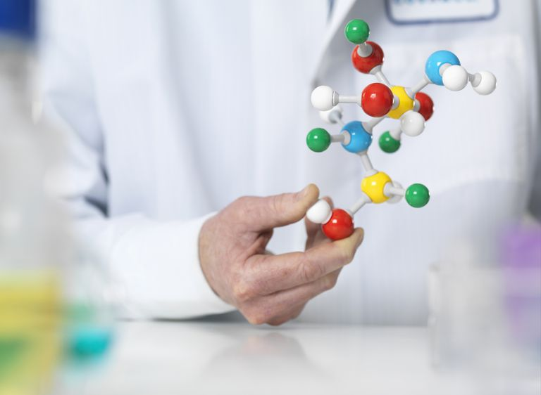 scientist holding model of chemical structure