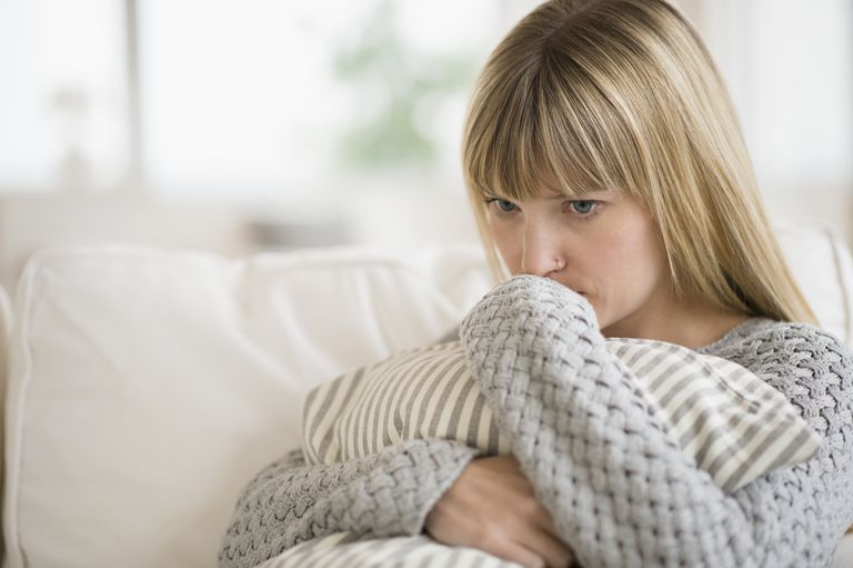 A woman experiencing symptoms of panic disorder