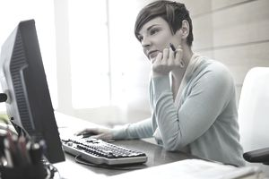 Businesswoman working on computer at office desk