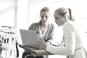 Two young women on a laptop