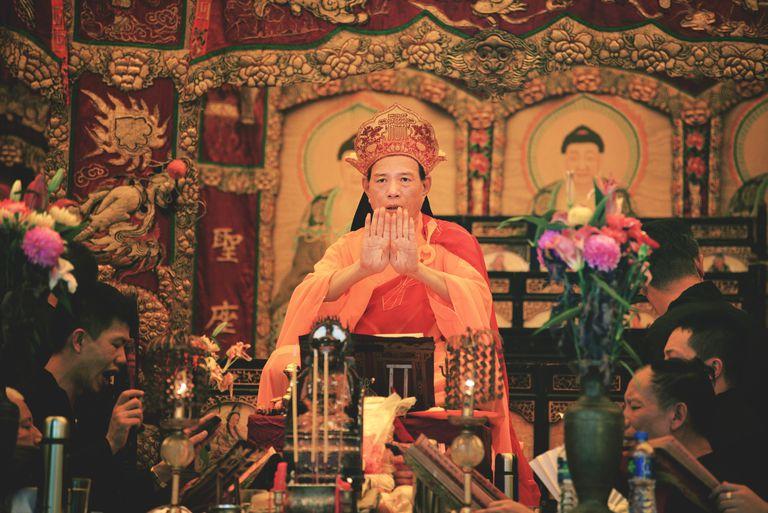 Chief monk chanting prayers