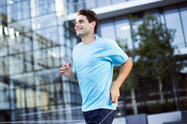 Man jogging outside urban building