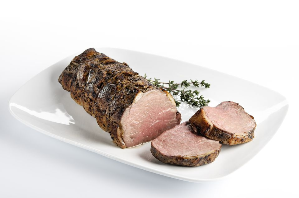 Cooked roast beef on a white plate