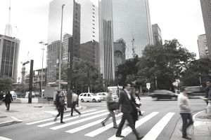 People and business commuters on Paulista Avenue