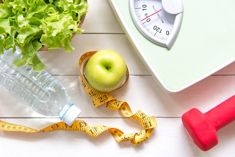 Green apple and weight scale