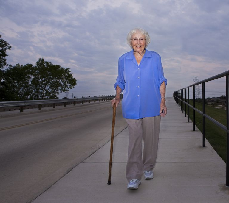 Picture of a woman walking with a cane.