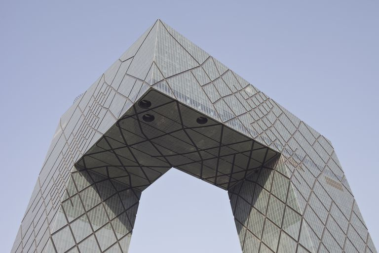 vertical and horizontal sections form a modern arch, two towers joined by a cantilever bridge, clad in diamond shapes