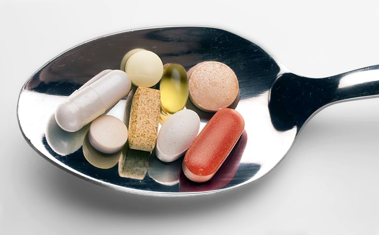 pills on spoon