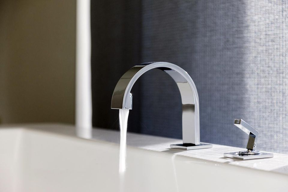 Water emitting from modern faucet