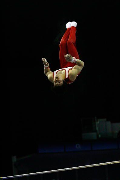 The 2009 world all-around champion, Japanese gymnast Kohei Uchimura, competes on high bar