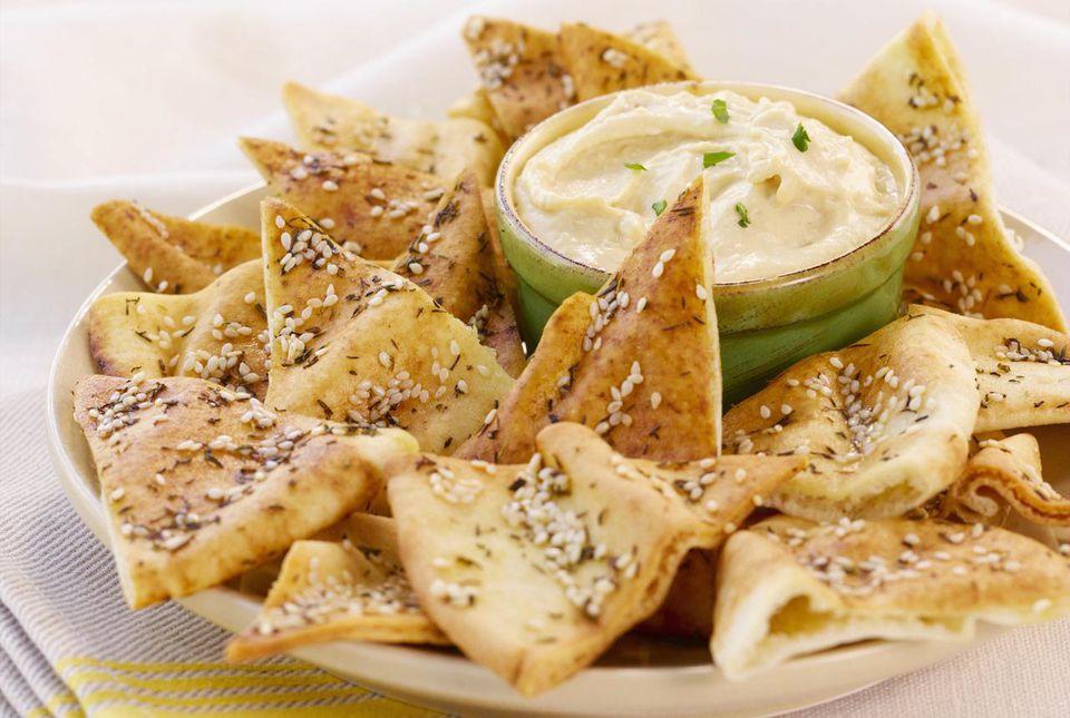 Pita chips with artichoke dip.