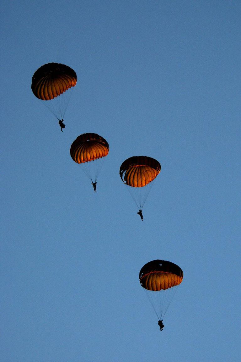 Soldiers of the First Marine Division parachute from a HC-46 Sea Knight helicopter during combat readiness training, September 25, 2001 at Camp Pendleton, California, north of San Diego.