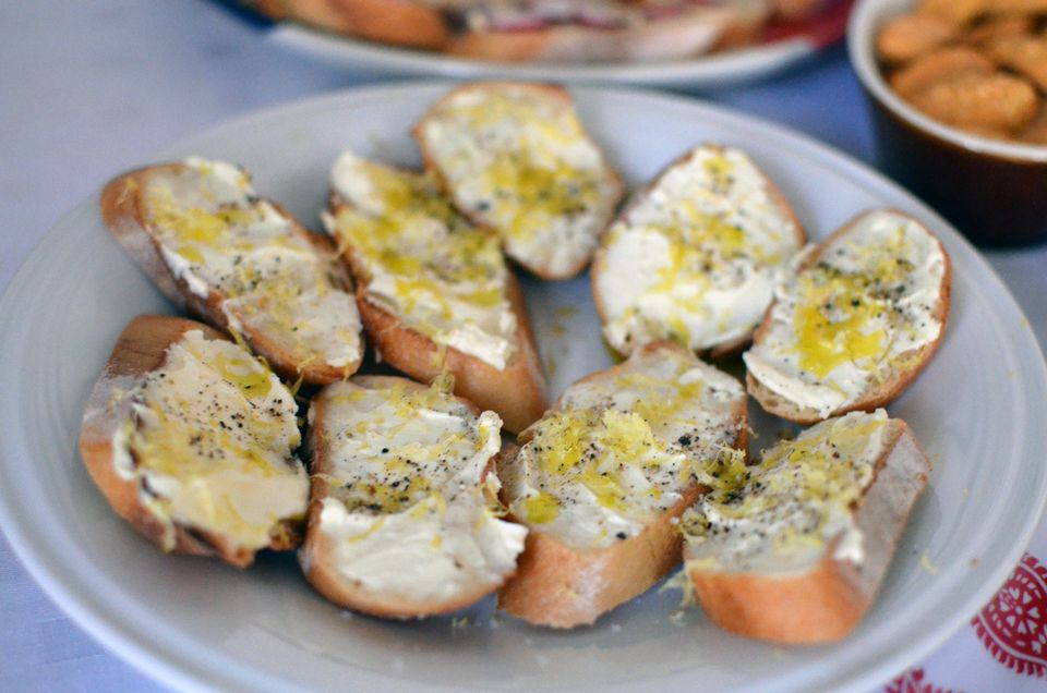 Fresh ricotta crostini with lemon zest, extra-virgin olive oil, black pepper, and fleur de sel