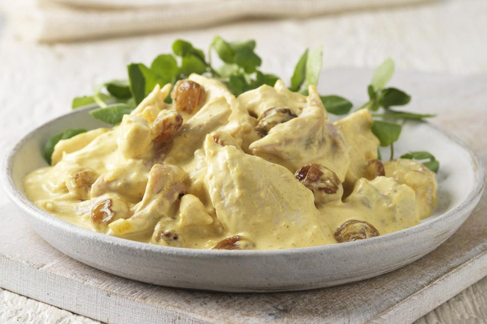 Plate of coronation chicken with salad