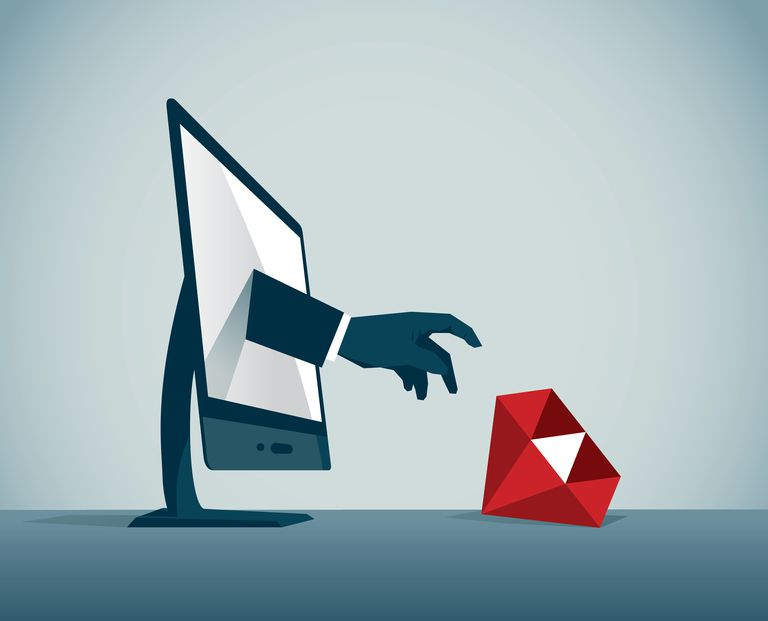 hand reaching out of a computer to grab ruby