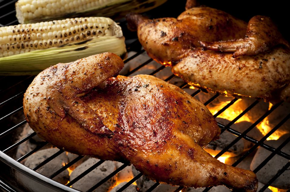 Whole chicken halves on grill