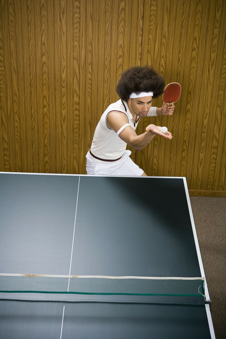 Man with Afro Playing Table Tennis