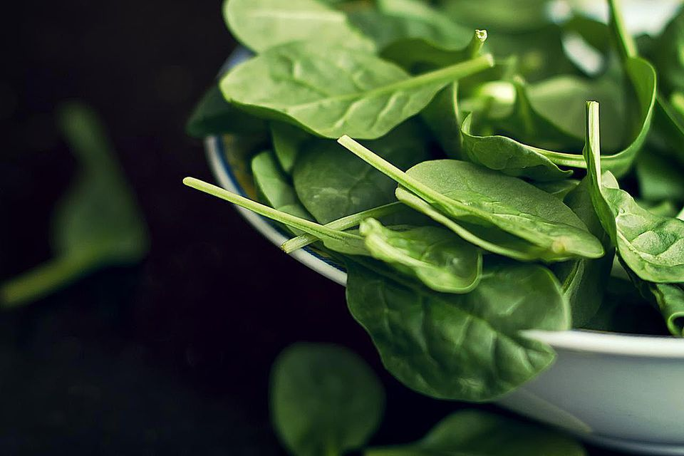 Spinach salad in bowl.
