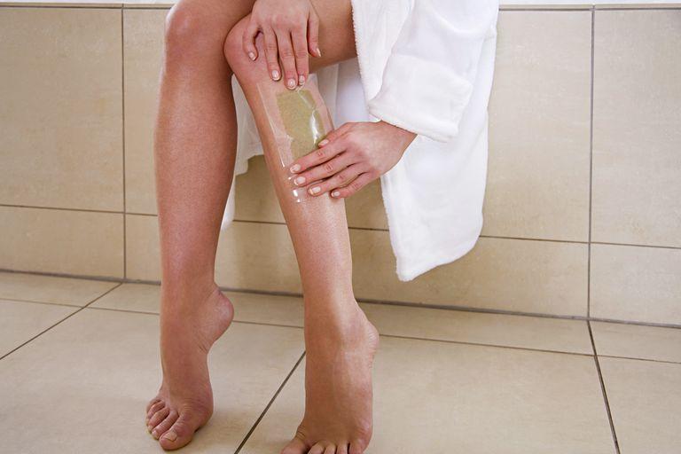 Woman waxing her legs