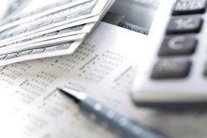 cash, calculator and calendar