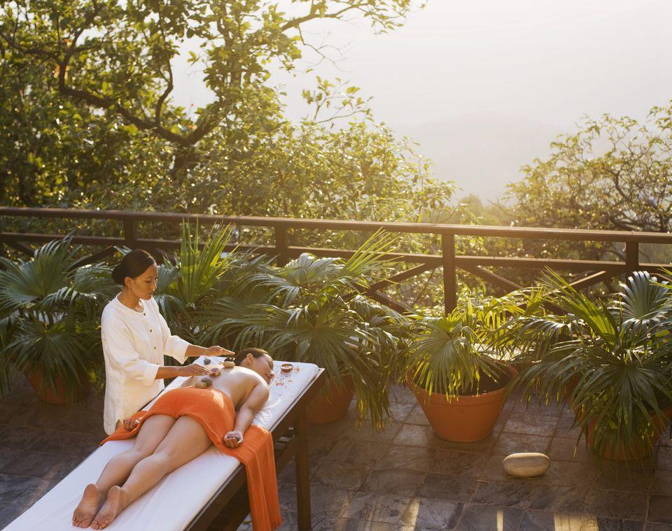 Woman Receiving Tibetan Massage at Sunset