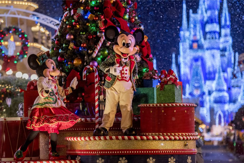 Mickey and Minnie Mouse aboard a holiday float in Christmas Parade at Disney's Magic Kingdom.