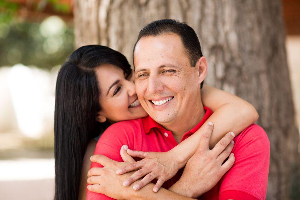 Smiling couple beneath a tree