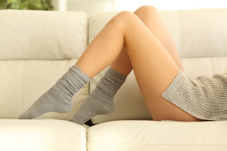 Woman waxed legs in winter at home