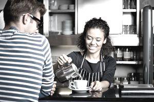 Girl workign in coffee shop