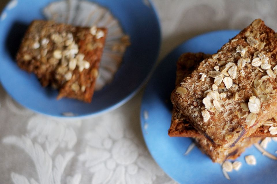 Oatmeal date bars on blue plates