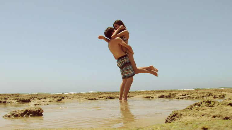 couple hug on beach in Spain