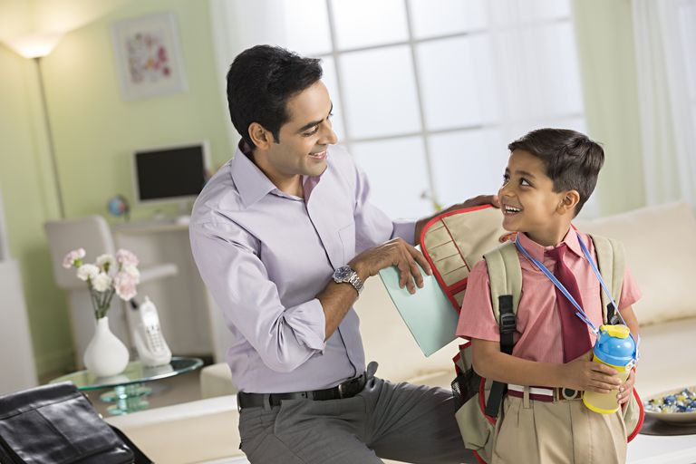 Father getting his son ready for school