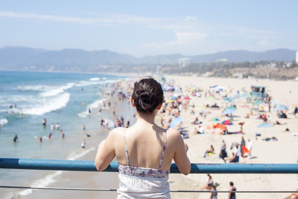 A woman takes in the view from the Santa Monica Pier
