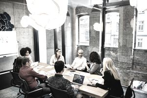 a group of people conversing in a conference room