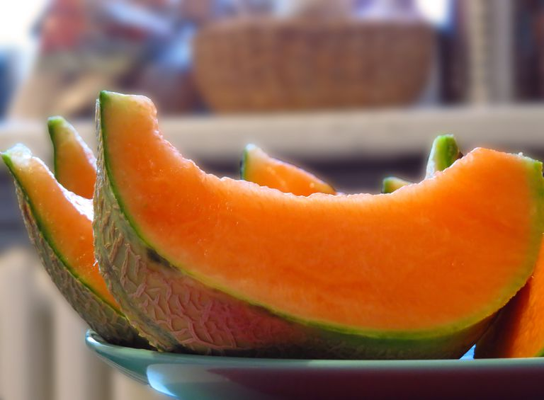 Close-Up Of Fresh Cantaloupe Slices On Plate