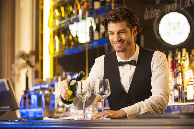 Barman pouring drinks during aperitivo
