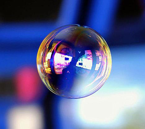 A soap bubble consists of a thin layer of water trapped between two layers of soap molecules.