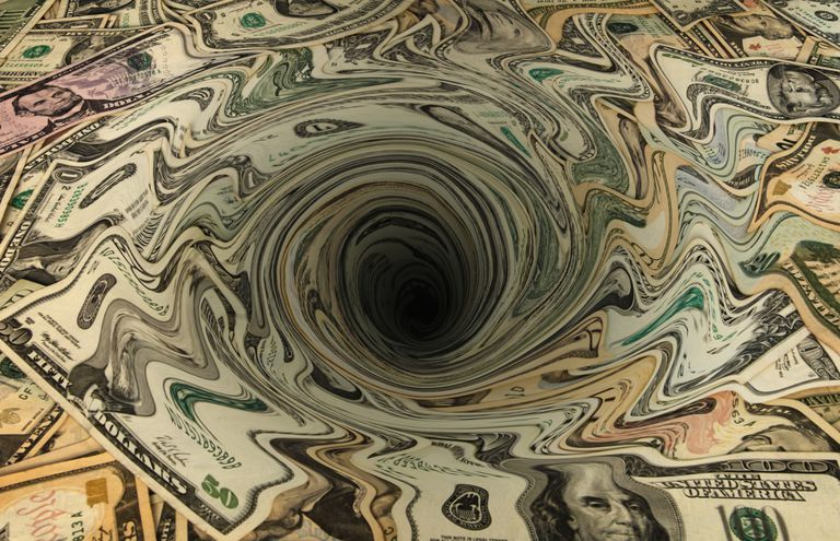 dollars in a whirlpool