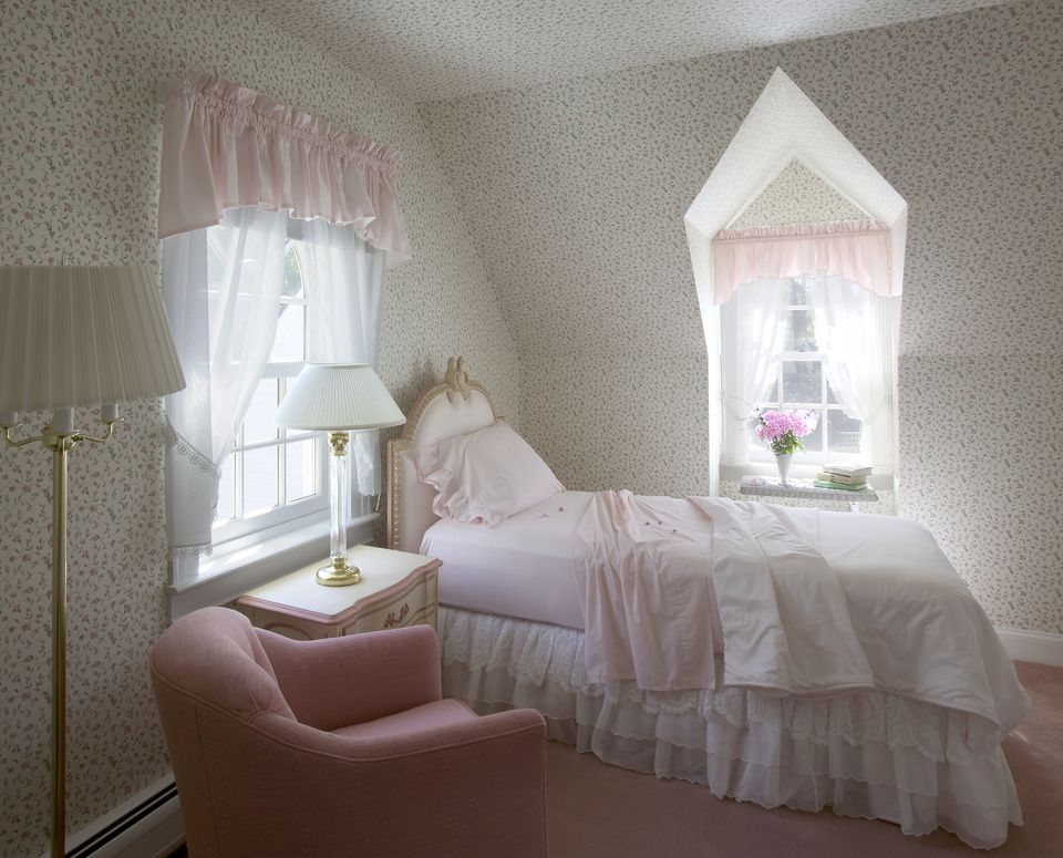 Side view of an elegant single bed in a classic bedroom