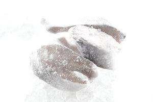 Frozen salmon steaks on ice cube