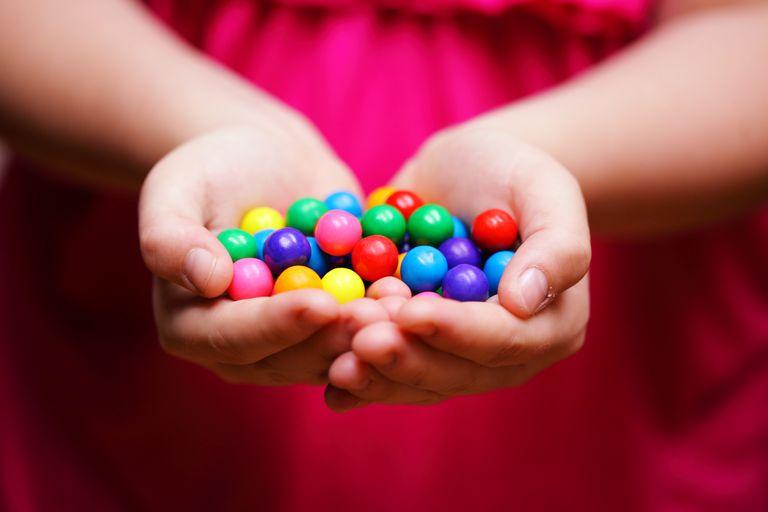 Child Holding Colorful Gum Balls