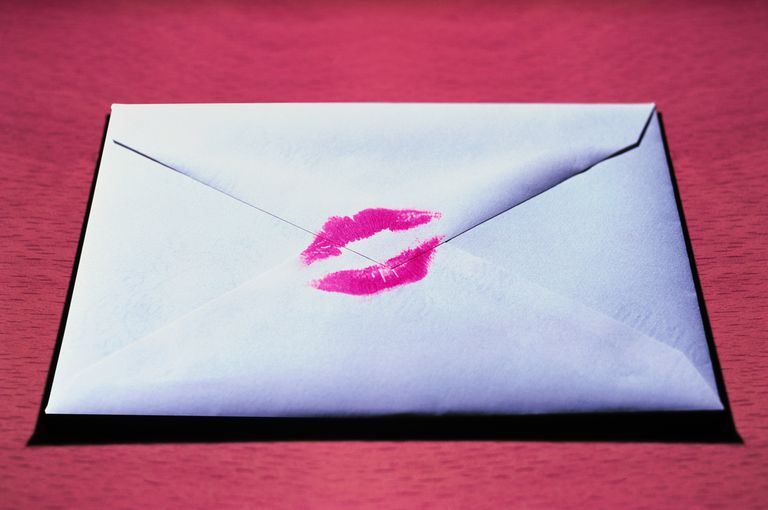 An envelope with a kiss on it