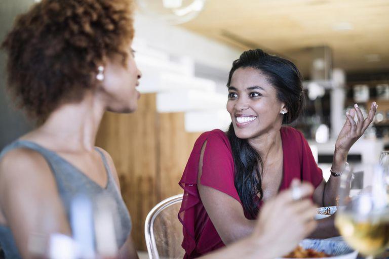 Two female friends having dinner