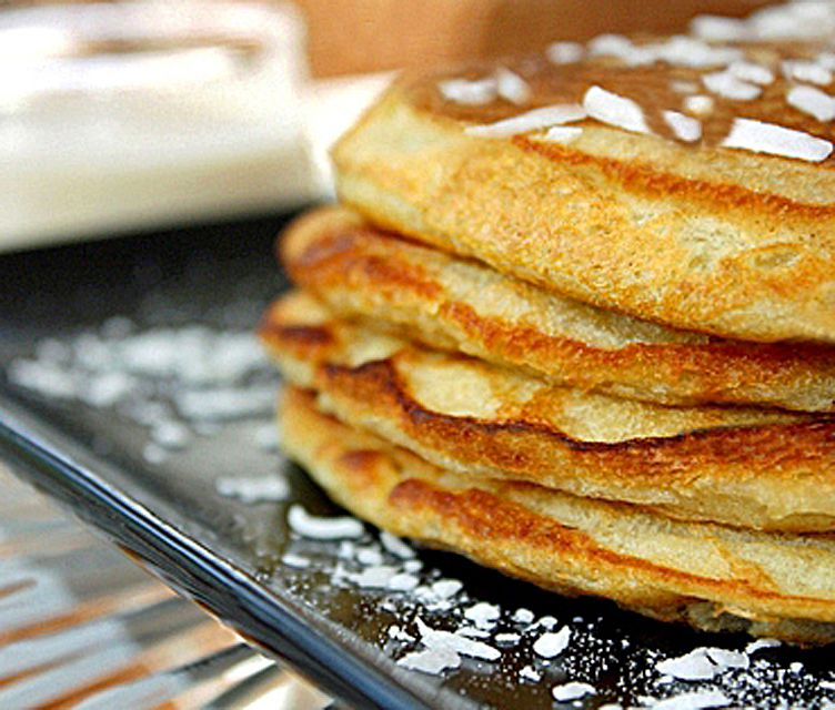 Coconut Pancakes with Coconut Syrup in the background - Delicious!