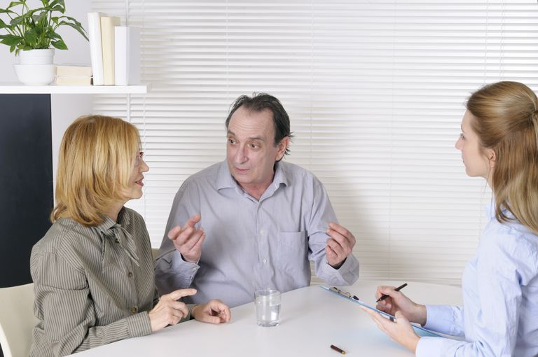 couple talking to patient advocate