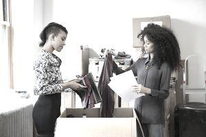 Fashion Designers Sorting Through a Shipment