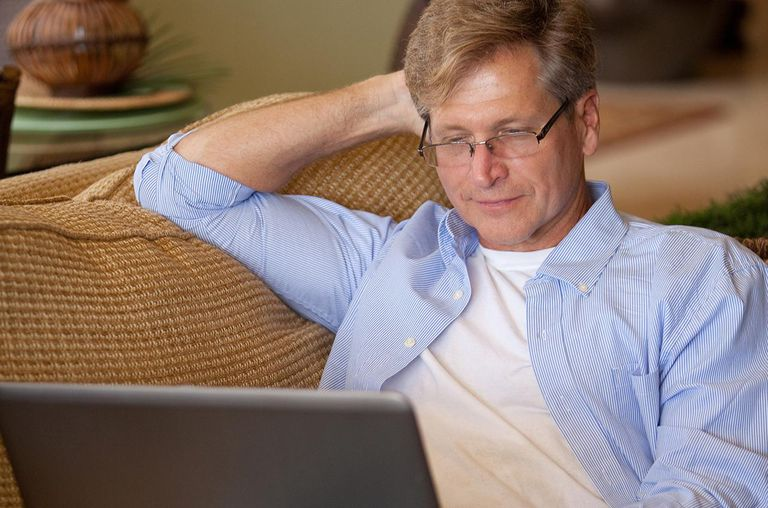 Man sitting on couch with computer